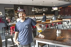 THIS GUY:  People can keep taking his picture, but Libertine Brewing Company Head of Brewing Operations Tyler Clark aims to keep the spotlight on his wild ales—and even wilder vinyl collection—in play now at the brewery's new Broad St. location. - PHOTO BY JAYSON MELLOM