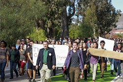 RIGHTS FIGHT:  Cal Poly President Jeffrey Armstrong walked with students in a march organized by SLO Solidarity, after the student group's leader received a death threat from a peer. - FILE PHOTO COURTESY OF CAL POLY
