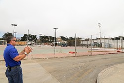 FOR THE LOVE OF ATHLETICS :  Morro Bay High School Principal Kyle Pruitt stands by his campus's tennis courts, which are in the process of being refurbished. Work for the high school's new pool is also underway. - PHOTO BY DYLAN HONEA-BAUMANN