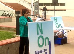 JUST SAYING NO:  Andrea Seastrand and members of the Central Coast Taxpayers association held a rally Sept. 12 to speak against a proposed transportation sales tax ballot measure. - PHOTO BY CHRIS MCGUINNESS