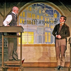 BAH HUMBUG!:  Ebenezer Scrooge (Beau Heckman) is the cold-hearted miser who berates the hard-working family man Bob Cratchit (Jeff Salsbury) in the Great American Melodrama's production of Charles Dickens' 'A Christmas Carol.' - PHOTO COURTESY OF THE GREAT AMERICAN MELODRAMA