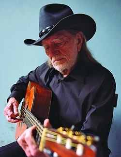 WILLIE & TRIGGER:  Country superstar Willie Nelson and his beloved Martin guitar, Trigger, appear at the Avila Beach Resort on Oct. 21. - PHOTO COURTESY OF WILLIE NELSON
