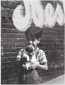 CHICANO:  Joe Schwartz's collection of photographs, Latin Diaspora, including pieces like 'Puppy Protector,' shows the lives of everyday people in Mexico and a housing project in Los Angeles. - PHOTO COURTESY OF THE SAN LUIS OBISPO MUSEUM OF ART