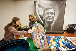 MAKING ART LOOK GOOD :  SLOMA Curator Ruta Saliklis, right, and Cal Poly student Rebecca Gates, left, prepare for an upcoming exhibit featuring the works of deceased artist Ralph Bacerra. - PHOTO BY JAYSON MELLOM