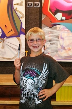 WHEN THE STUDENT'S READY, THE TEACHER APPEARS:  Local boy and artist Dylan Ehmke has been a fan of the famous street artist Man One for years. - PHOTO COURTESY OF JUST LOOKING GALLERY