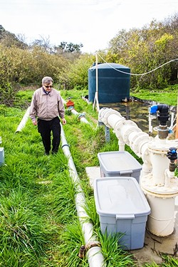 FLOWING:  Cambria Community Services District engineer Bob Gresens explains what it takes to purify water enough to supply it as a community resource. - PHOTO BY JAYSON MELLOM