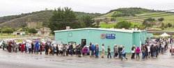 PEOPLE POWER :  Hundreds of SLO County Democrats lined up in the rain Jan. 7 to help elect a slate of 14 local progressives to represent them as delegates to the state-level Democratic Party. - PHOTO BY JAYSON MELLOM