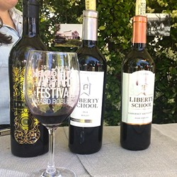 POPPIN' BOTTLES :  Hope Family Wines was just one of the many wineries pouring red blends, cabernets, rosé wines, and more at the Paso Robles Wine Festival on May 20. - PHOTO BY RYAH COOLEY