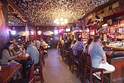 OLD-TIME FEEL:  Dark with dollar bills hanging from the ceiling—a bar can't really get any better than that. Old Cayucos Tavern and Cardroom really epitomizes that scene and takes the cake for Best North Coast Bar. - PHOTO BY JAYSON MELLOM