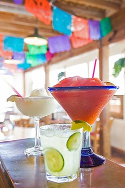 MARGARITA HEAVEN:  Old Juan's Cantina in Oceano has margaritas on margaritas—in practically any flavor you'd want. Pictured on the bar from front to back are the Cucumber Margarita, Super Strawberry Margarita, and Margarita Classico. - PHOTO BY JAYSON MELLOM