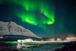 SURREAL:  While Chris Burkard and company were forced out of one surf spot in Iceland by a storm, they did manage to catch some waves under the famous Northern Lights while filming 'Under an Arctic Sky.' - PHOTO COURTESY OF CHRIS BURKARD