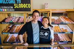 NUTS OF DOUGH :  Brandon Miller and Nonny Ross are ready to serve you the best doughnuts in SLO County at SloDoCo. - PHOTO BY JAYSON MELLOM