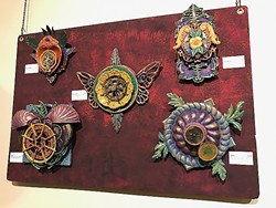 REPURPOSED PALETTE:  Gears, compasses, silver dishes, lazy Susans, and Jell-0 molds are all a part of artist Janelle Younger's palette of found objects. - PHOTO BY TREVER DIAS