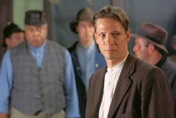 ORGANIZE! :  Chris Cooper (foreground, in his film debut) stars as Joe Kenehan, a union organizer in 1920 West Virginia trying to help Matewan's embattled coal miners. - PHOTO COURTESY OF  CINECOM ENTERTAINMENT GROUP