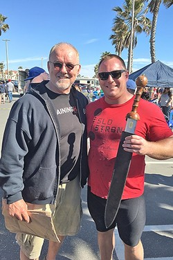 STRONG MAN:  Andrew Wickham (right) holds the California's Strongest Man trophy he won the last weekend in March as he stands next to World's Strongest Man legend Odd Haugen. - PHOTO COURTESY OF SLO STRONG