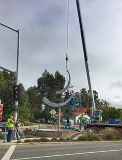 INSTALLATION Sculptor Jeffery Laudenslager's monumental kinetic sculpture Olas Portola is installed in SLO Town on June 9. - PHOTO BY GLEN STARKEY
