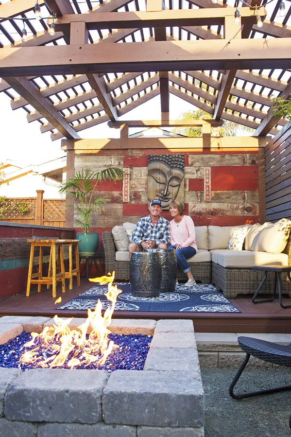 PERFECT GETAWAY Because their Shell Beach home is small, Kevin and Susan Bratcher spread out in all directions, creating an Asian pergola in the backyard that doubles as a stage for house concerts. - PHOTO BY JAYSON MELLOM