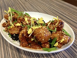 DON'T MISS THE MEAT Korean heirloom cauliflower wows with black rice, sesame, and gold pea shoots. - PHOTO BY REID CAIN