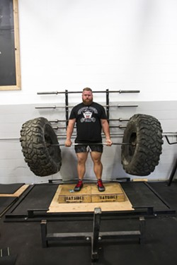 HEAVY LIFTING Scott O'Farrell of SLO Strong deadlifts a bar with a set of tires. - PHOTO BY JAYSON MELLOM