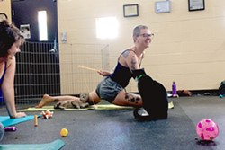 COGA TIME Bring your yoga mat, some water, and a friend to Woods Humane Society every Sunday at 10:15 a.m. for Cat Yoga. - PHOTO COURTESY OF ERICA HUDSON