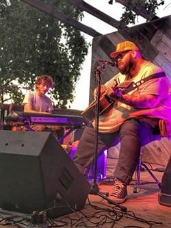 TENDER LAMENTS John Moreland (right) and his accompanist John Calvin Abney dazzled the crowd with heart-wrenching songs and sparkling musicianship. - PHOTO BY GLEN STARKEY