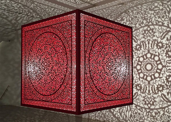IMMERSIVE A single bulb in artist Anila Quayyum Agha's installation piece on display at Cuesta College's Harold J. Miossi Gallery reflects an intricate pattern onto the walls and floor. - PHOTO COURTESY OF THE HAROLD J. MIOSSI GALERY
