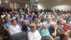 FULL HOUSE Supporters of SLO County Sheriff Ian Parkinson and family and friends of Andrew Holland packed a Board of Supervisors meeting to address issues of health and safety at the SLO County Jail Aug. 22. - PHOTO BY CHRIS MCGUINNESS