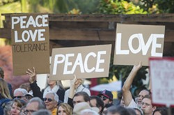 "A CALL FOR PEACE SLO County residents packed Mission Plaza to stand in solidarity against hate as part of a ""outshine the darkness"" rally Aug. 12. - PHOTO BY JAYSON MELLOM"