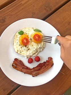 SUNNY SIDE WHAT? Whether scrambled, poached, fried with a runny yolk or simmered solid, an egg is really never just an egg. Just ask the masses: No one person takes theirs exactly the same. That would just be creepy. - PHOTO BY HAYLEY THOMAS CAIN