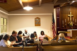 PRACTICE Anita Schwaber of By the Sea Productions (far left) and cast members read a script for their upcoming play, Member of the Wedding, at St. Peter's By The Sea Episcopal Church in Morro Bay. - PHOTO BY JAYSON MELLOM