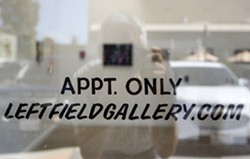 LIMITED VIEWINGS Left Field is now open the first Friday of the month during Art After Dark from 6 to 9 p.m. or, as the sign says, by appointment. - PHOTO BY JAYSON MELLOM