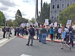 ON THE MARCH When negotiations fail, local unions can threaten to call for a strike, like these members of the California Faculty Association at Cal Poly. - FILE PHOTO