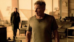 ON THE BRINK With society nearly in ruins, officer K (Ryan Gosling, left) looks to find answers by searching for Rick Deckard (Harrison Ford, right), a former LAPD blade runner who went missing 30 years ago in Blade Runner 2049. - PHOTO COURTESY OF WARNER BROS. PICTURES