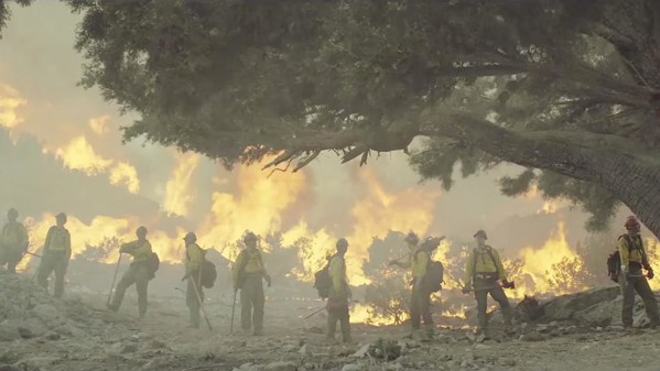 STAND YOUR GROUND The Granite Mountain Hotshots battled the famed Yarnell Hill Fire in 2013. - PHOTO COURTESY OF BLACK LABEL MEDIA