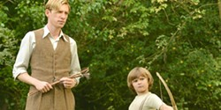 HUNDRED ACRE WOOD Author A.A. Milne (Domhnall Gleeson) finds inspiration to write Winnie the Pooh thanks to his son, Christopher Robin (Will Tilston), in Goodbye Christopher Robin. - PHOTO COURTESY OF FOX SEARCHLIGHT PICTURES