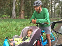 GINGER MAN Michael Huggins and baby daughter Cedar Huggins-Denbow take a spin around Dacite Farm in SLO. Two years ago, the farm received guidance and local funding via local nonprofit Slow Money SLO, allowing Huggins to erect a greenhouse and supply certified organic turmeric, ginger, and tomatoes to local folks. - PHOTOS COURTESY OF SLOW MONEY SLO