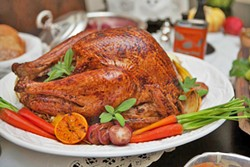 "SLICE IT UP, SLEEP IT OFF Gluttony, sloth, and—of course—political disagreements will abound this Thanksgiving. Take Flavor writer Hayley Thomas Cain's advice, and ""roll with it."" Oh, and pass the rolls, please! - PHOTO COURTESY OF DINA MANDE"