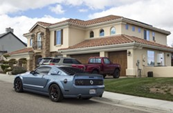 LAP OF LUXURY Multi-millionaire lotto winner Charles Hairston gifted this $819,000 home and a 2016 Porsche to Tiffany Borba, an unlicensed caregiver who now has power of attorney over his finances and medical care. - PHOTO BY JAYSON MELLOM