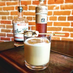 LOCALLY-CRAFTED MARVEL At Hatch Rotisserie, Robin Wolf is crafting lovely winter wonders like this concoction containing bourbon, sweet potato liqueur, Paso Wine Shine, molasses, cream, and holiday spice, with a brûlée marshmallow. - PHOTO COURTESY OF ROBIN KIRK WOLF