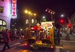 COWBOY UP! Local country music hero Monte Mills pumps up the crowd during the 42nd annual Holiday Parade. The theme this year was Holiday Hoedown. - PHOTO BY JAYSON MELLOM