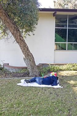 RESTING A man sleeps in downtown San Luis Obispo. - PHOTO BY JAYSON MELLOM