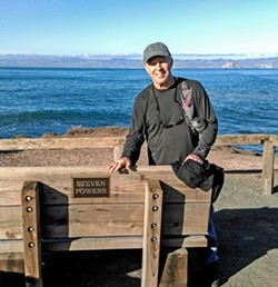 GOT THE POWER(S) Steve Powers, who has worked as an arts promoters for more than 40 years, stands by a bench named for a different Steve Powers at Montana de Oro. - PHOTO COURTESY OF STEVE POWERS
