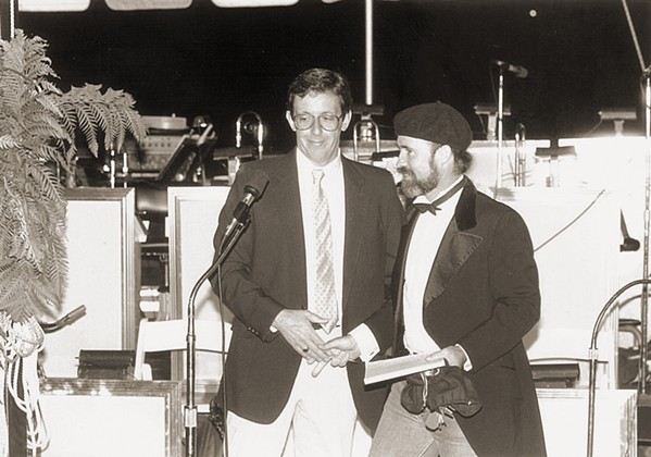 THROWBACK Frank Lanzone, general manager of KCBX, and Archie McLaren at the Central Coast Wine Classic in its early days, back in 1986. - PHOTO COURTESY OF HISTORY CENTER OF SLO COUNTY