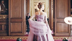 COMING UNDONE In Phantom Thread, women come in and out of renowned dressmaker Reynolds Woodcock's (Daniel Day-Lewis, background) life, until Alma (Vicky Krieps, foreground) comes along to fill the role of lover and muse. - PHOTO COURTESY OF FOCUS FEATURES