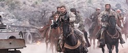 WAR In the aftermath of 9/11, Capt. Mitch Nelson (Chris Hemsworth, left) leads a U.S. Special Forces team into Afghanistan on a dangerous mission in 12 Strong. - PHOTO COURTESY OF WARNER BROS. PICTURES