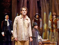 HE SAID, SHE SAID, THEY SAID Andrew Philpot (pictured foreground) delivers a dynamic and complex performance as John Proctor in Pacific Conservatory Theater (PCPA)'s new production of The Crucible. - PHOTO COURTESY OF LUIS ESCOBAR REFLECTIONS PHOTOGRAPHY STUDIO