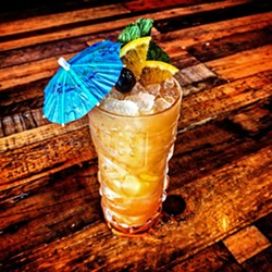 """COCONUT DREAMS As strong as they come, Sidecar's """"Bahama Mama"""" is made with Gosling's Black Seal rum, Ron Matusalem Platino rum, Havana Club rum, Clement coconut liqueur, pineapple, orange, grenadine, and Angostura bitters. - PHOTO COURTESY OF SIDECAR"""