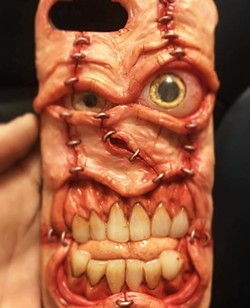 """CREEPY CRAWLY Grover Beach artist Joe Rowles crafts functional pieces like this cellphone case that he classifies as """"grotesque art."""" - PHOTO COURTESY OF JOE ROWLES"""