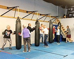 REGAINING STRENGTH Members of Rock Steady Boxing Central Coast are tackling their Parkinson's symptoms with boxing training. - PHOTO BY KAREN GARCIA