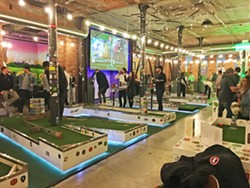 CHEERS TO GAMES AND BEER On a Friday night, Flatstick is crowded with people talking, enjoying a cold brew, and playing a healthy but competitive round of mini golf. - PHOTO BY KAREN GARCIA